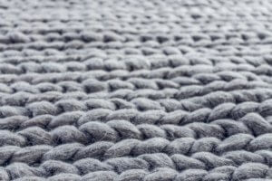 close up of gray cable knit cloth 1421253 300x200